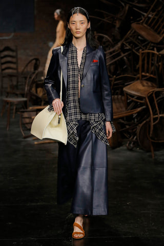 the-brita-blazer-in-navy-leather,the-selma-pant-in-navy-leather,the-braided-sandal-in-cognac