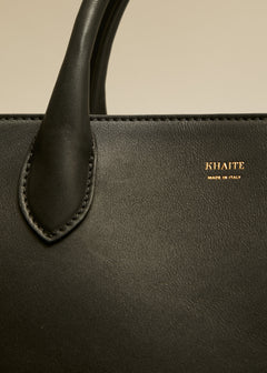 The Large Envelope Pleat Tote in Black Leather