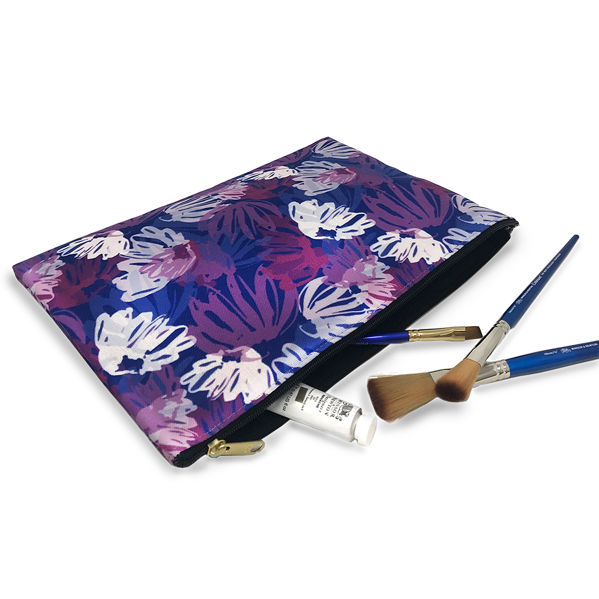 Blue pink white floral pattern on canvas zip case shown in use