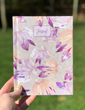 Journal with pink, tan, and salmon floral pattern watercolor in hand