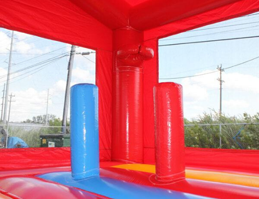 Commercial bounce house with basketball hoop
