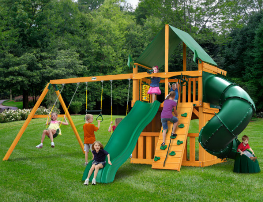 kids playing on the gorilla mountaineer with clubhouse swing set