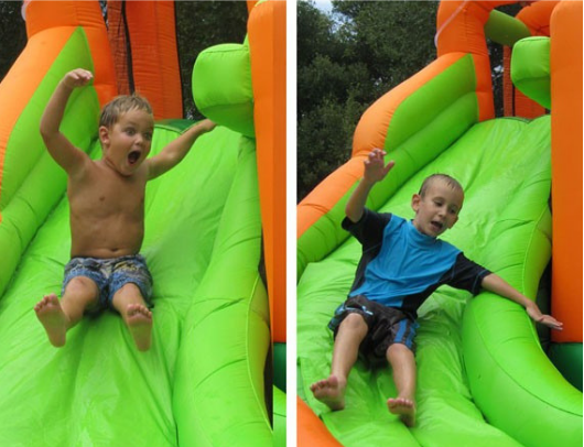 Kidwise Endless Fun 11 in 1 Bounce House and Waterslide boys on slide