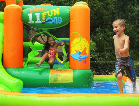 Kidwise Endless Fun 11 in 1 Bounce House and Waterslide kids playing