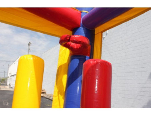 balloon bounce house combo has an inflatable basketball hoop and pop up obstacles
