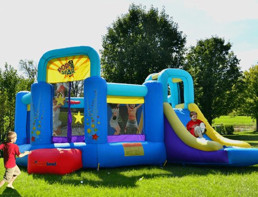 residential bounce house with slide by bounceland