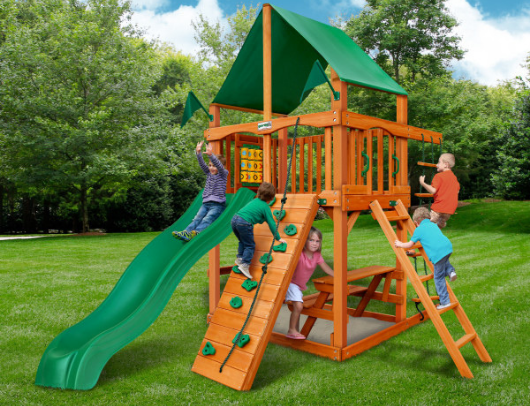 gorilla chateau tower playset with kids playing outdoors
