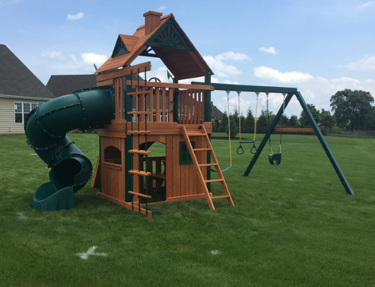 gorilla mountaineer clubhouse swing set in the backyard