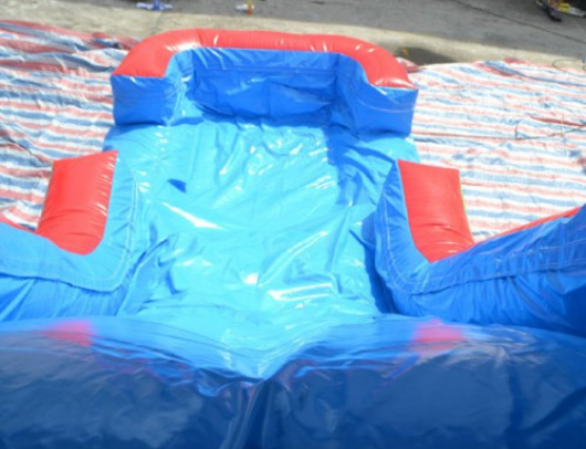 large inflatable slide part of commercial bounce house