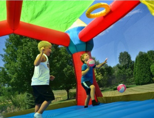playing basketball in the bounceland party castle bounce house