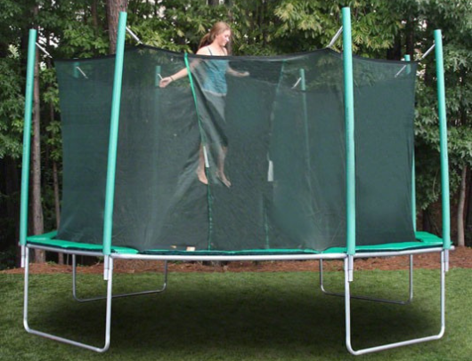 jumping on the magic circle octagon trampoline with safety enclosure