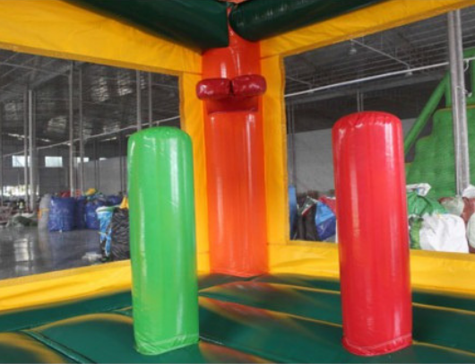 palm tree commercial bouncy house with inflatable basketball hoop and pop up obstacles