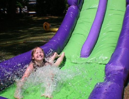 racing with the bounceland double water slide