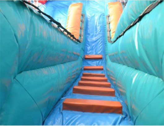 stairs leading to the top of the inflatable slide platform