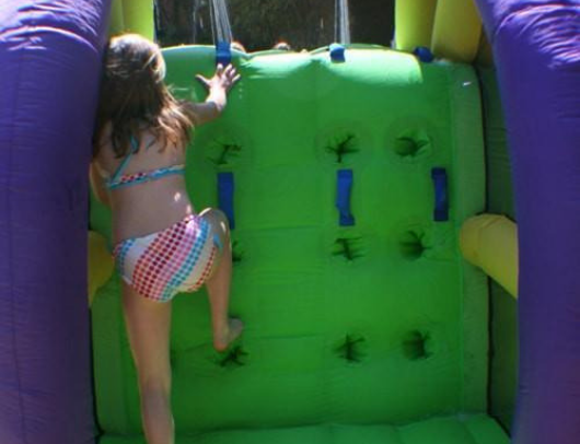 rock climbing wall on bounceland double water slide