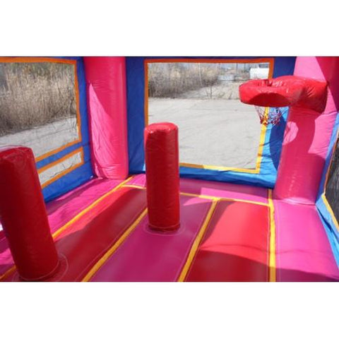 obstacles and basketball hoop inside the princess bounce house