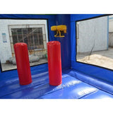 obstacles and a basketball hoop inside the sports module commercial bounce house