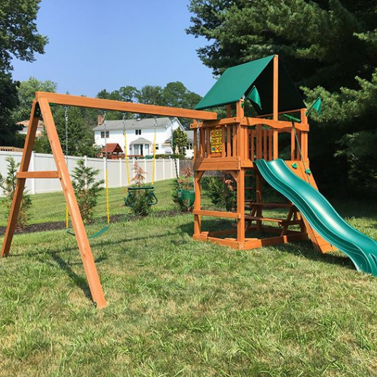Chateau swing set with nylon canopy in backyard
