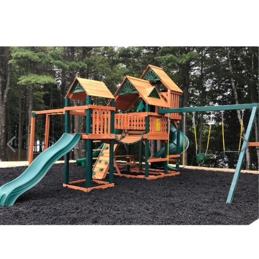 Gorilla Empire Extreme Wooden Swing Set on mulch