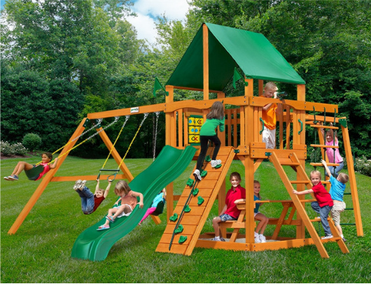 Gorilla Playsets Navigator Wooden Swing Set with Deluxe Vinyl Green Canopy outside