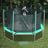 Image of bouncing on the magic circle trampoline with safety enclosure