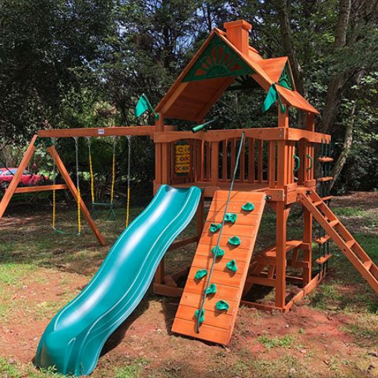 chateau swing set with wood roof