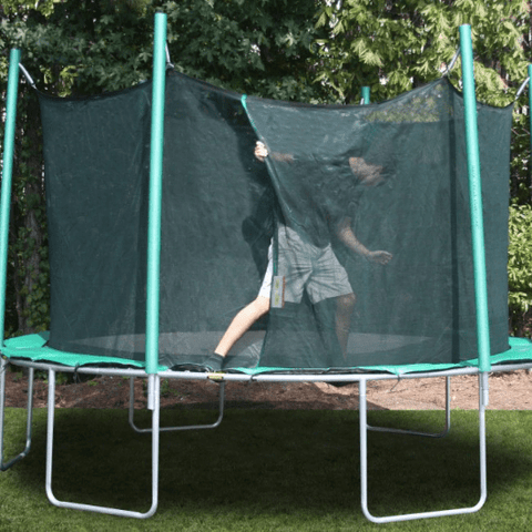 climbing into 13.5' round magic circle trampoline with safety cage