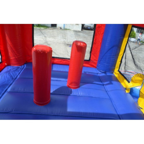 obstacles and basketball hoop inside the commercial bounce house