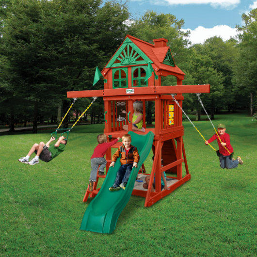 kids playing outdoors on the gorilla five star space saver swing set
