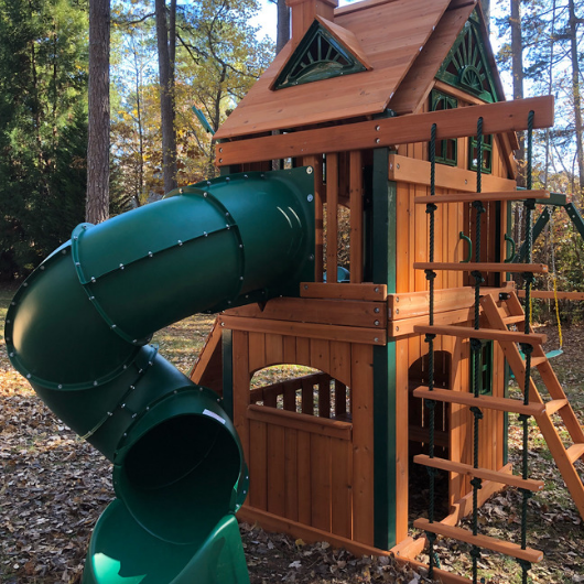 mountaineer clubhouse swing set with treehouse roof in the backyard