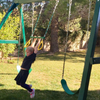 Image of kid on congo swing central swing set trapeze bar