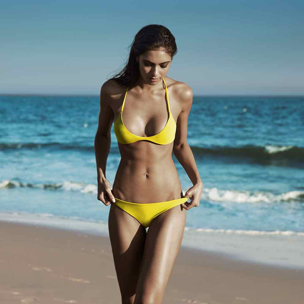This is our Jill A Sexy Sporty Racerback Athletic Inspired Brazilian Bikini Top With Polished Silver Finish Metal Ring Detail In Signature Yellow Primrose Matte Finish