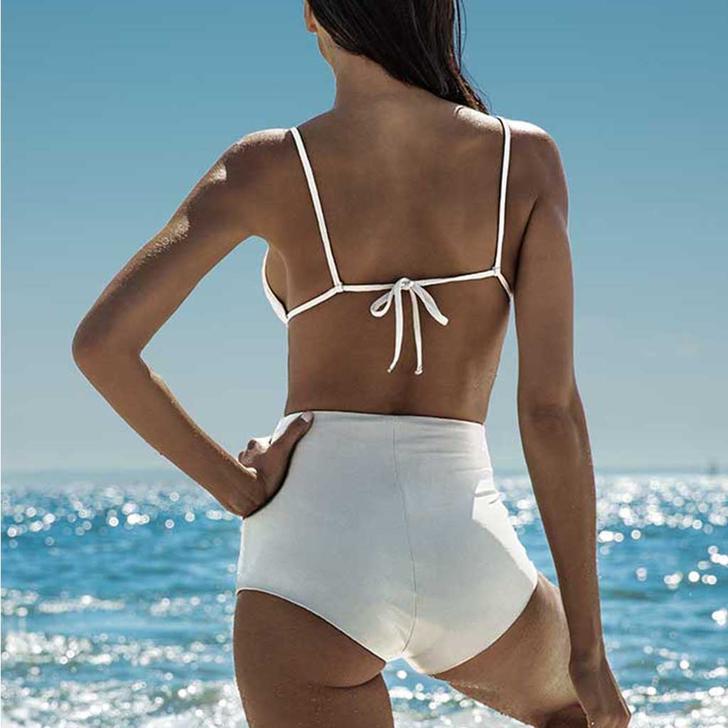 this is our kim highwaist cheeky bikini bottom worn with rafa shoulder strap top all in white matte finish fabric