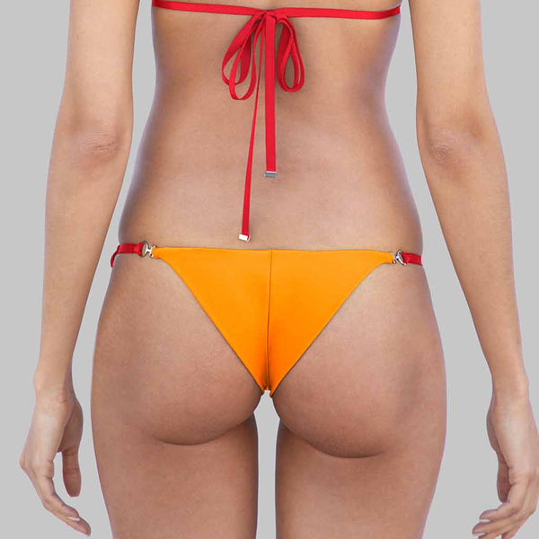 "This is our  ""Chameleon"" Triangle Halter Brazilian Bikini Bottoms With Adjustable Side Ties With Metal Ends In Signature Color Block Cherise/Orange Matte Finish Fabric"
