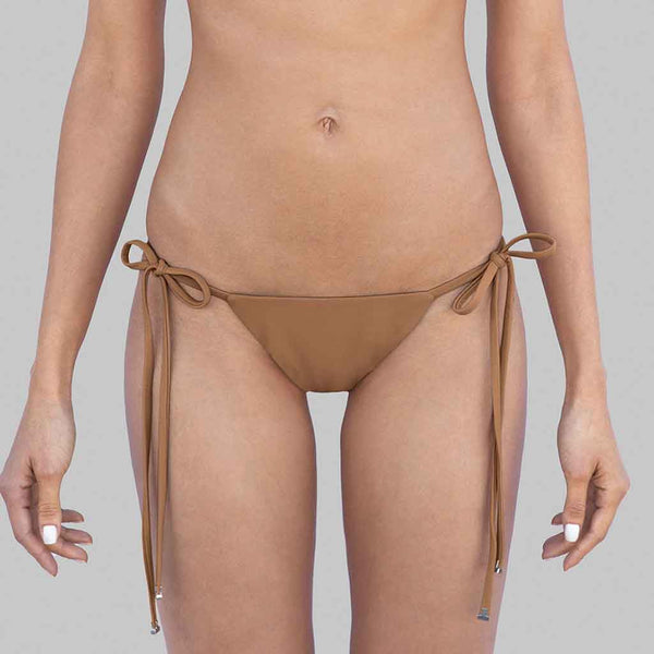 This is our kelly side-ties brazilian cut bikini bottom in champagne color matte finish fabric