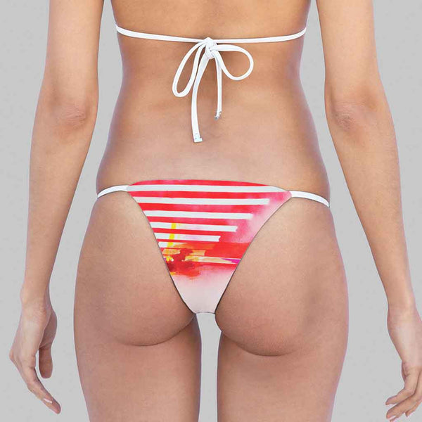 This is our kelly side-ties brazilian cut bikini bottom in exclusive print by jenny hager  crimson color