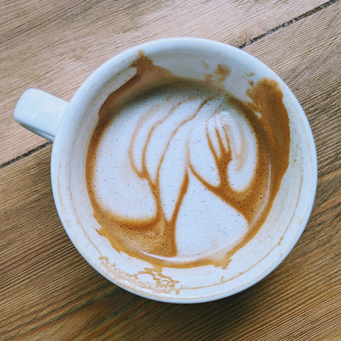 Bird's Eye image of a cappuccino with foam art looking like trees