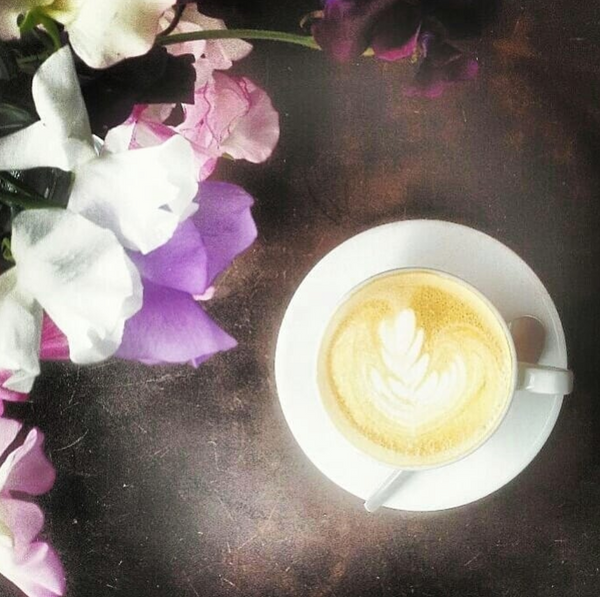 Coffee with purple and white orchids