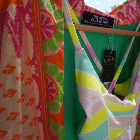 Close up of a pink and orange jacket with a neon swimsuit