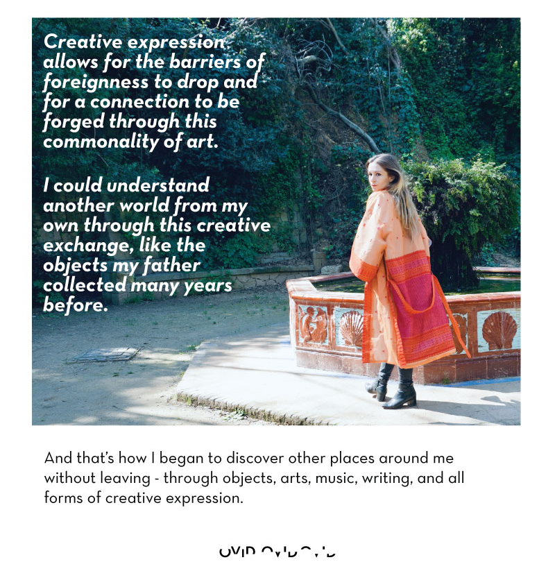 Woman in orange jacket at a fountain outside with text.
