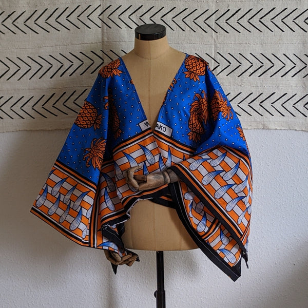 Short kaftan in blue with orange pineapples on kitenge wax print
