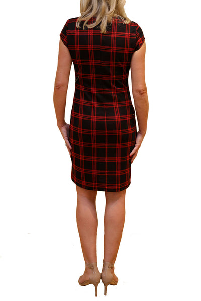 Rear view of plaid dress with asymmetrical zipper detailing.