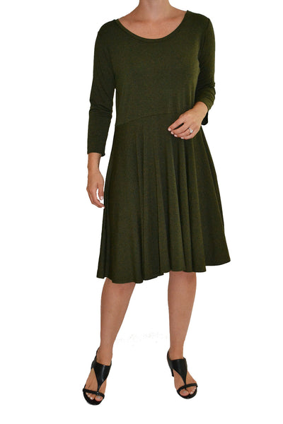 Salaam dress with flattering waistline in the color olive.