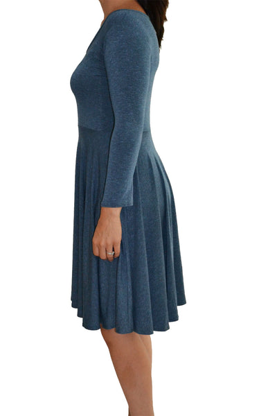 Side image of Salaam dress in light blue reaching just to the knee in length.