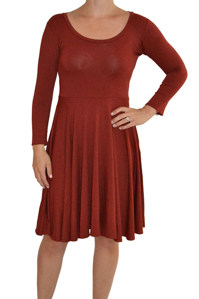 Salaam Dress with wide scoop neckline, 3/4 length sleeves, and knee length hem in the color rust.