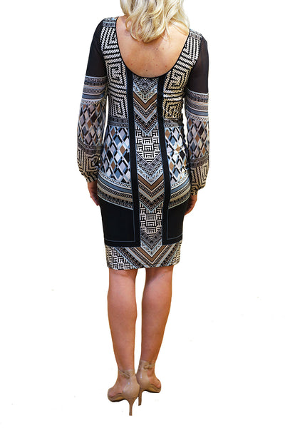 Rear view of fitted dress in abstract pattern from Analili.