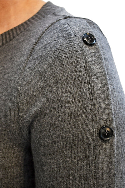 Close up of brushed sweater dress with button detailing along bell sleeves.
