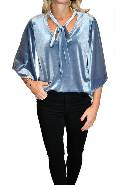 Tucked velvet top from Kay Celine with tie detailing at neckline.