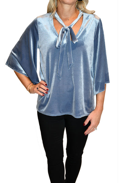 Untucked, ice blue velvet blouse with 3/4 length flare sleeves from Kay Celine.