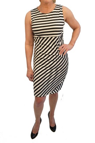 Empire waist sleeveless dress with mixed stripe print reaching just to the knee.